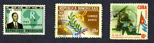 independence stamp, Rwanda, 1962, and 1st anniversary of a coup stamp, Dominican Republic, 1962, and defeat of invasion stamp, Cuba, 1962