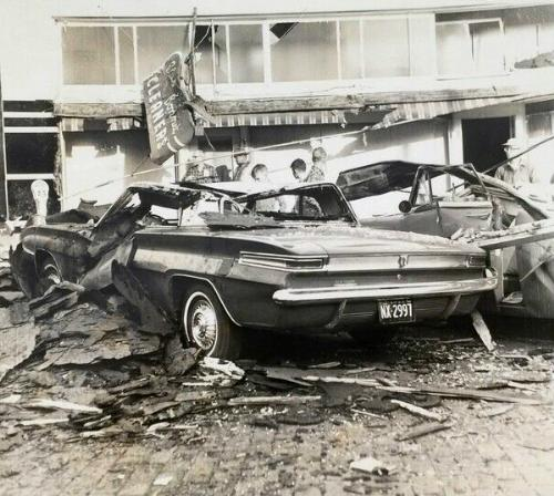 Damaged new Buick in debris from Mineola, Texas tornado, 1962